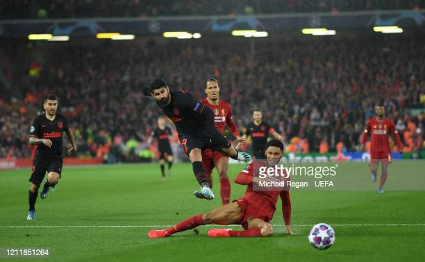 Diego Costa of Atletico Madrid shoots while under pressure from Joe Gomez of Liverpool during the UEFA Champions League round of 16 second leg match...