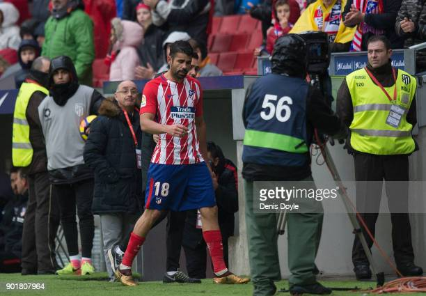 Diego Costa of Atletico Madrid walks off the pitch after being sent off during the La Liga match between Atletico Madrid and Getafe at estadio Wanda...
