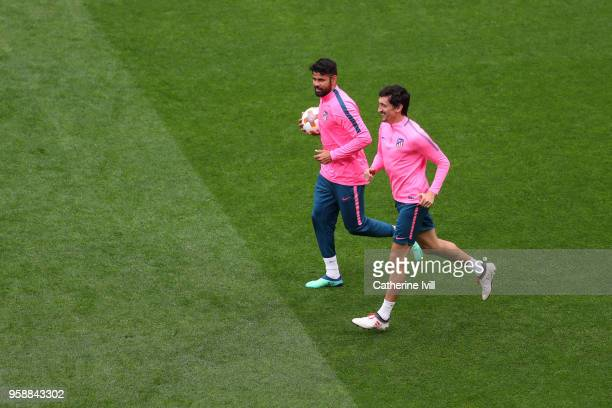 Diego Costa of Atletico Madrid warms up Stefan Savic of Atletico Madrid during a Club Atletico de Madrid training session ahead of the the UEFA...