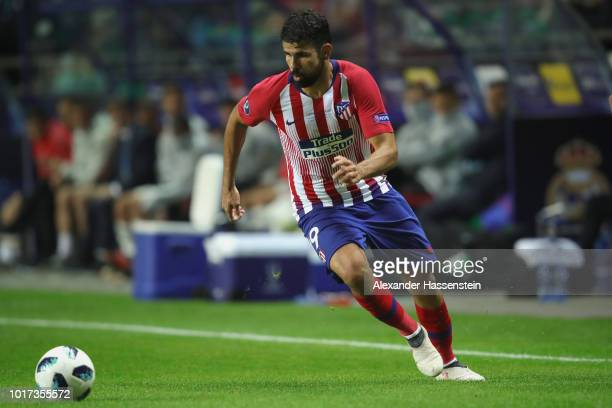 Diego Costa of Atletico runs with the ball during the UEFA Super Cup between Real Madrid and Atletico Madrid at Lillekula Stadium on August 15 2018...