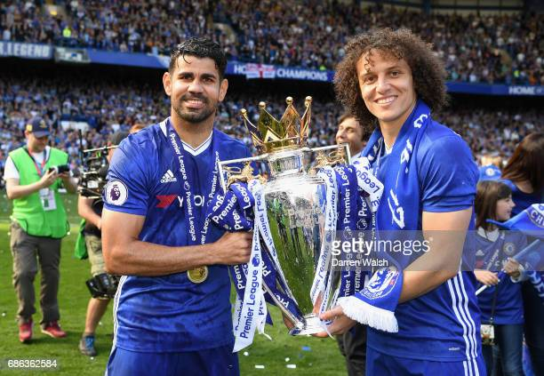 Diego Costa of Chelsea and David Luiz of Chelsea pose with the Premier League Trophy after the Premier League match between Chelsea and Sunderland at...