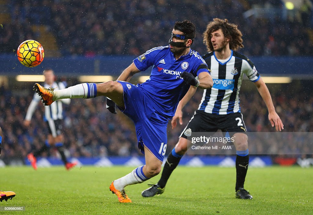 Diego Costa of Chelsea and Fabrizio Coloccini of Newcastle United during the Barclays Premier League match between Chelsea and Newcastle United at Stamford Bridge on February 13, 2016 in London, England.