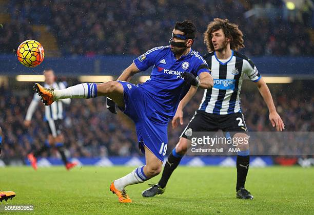Diego Costa of Chelsea and Fabrizio Coloccini of Newcastle United during the Barclays Premier League match between Chelsea and Newcastle United at...