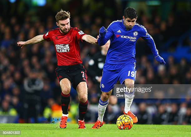 Diego Costa of Chelsea and James Morrison of West Bromwich Albion compete for the ball during the Barclays Premier League match between Chelsea and...