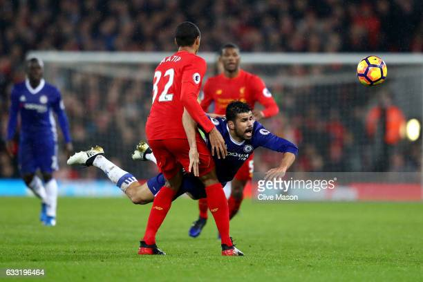 Diego Costa of Chelsea and Joel Matip of Liverpool compete for the ball during the Premier League match between Liverpool and Chelsea at Anfield on...