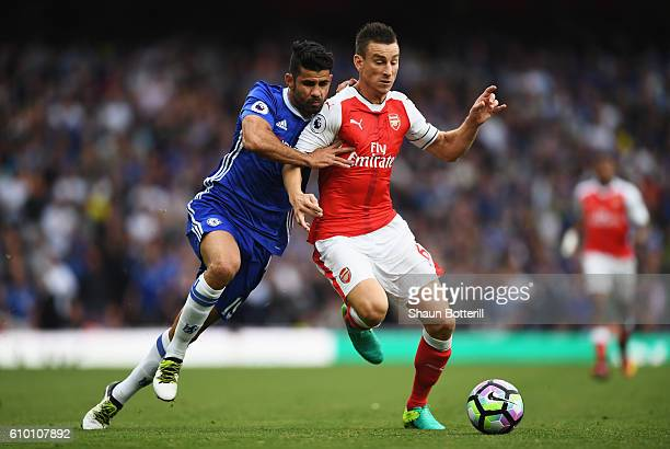 Diego Costa of Chelsea and Laurent Koscielny of Arsenal battle for possession during the Premier League match between Arsenal and Chelsea at the...