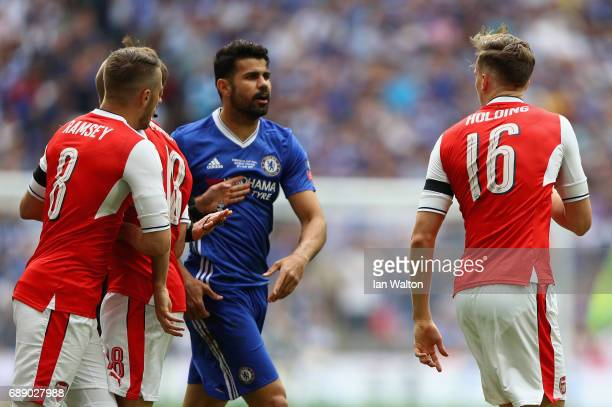 Diego Costa of Chelsea and Rob Holding of Arsenal exchange words during The Emirates FA Cup Final between Arsenal and Chelsea at Wembley Stadium on...