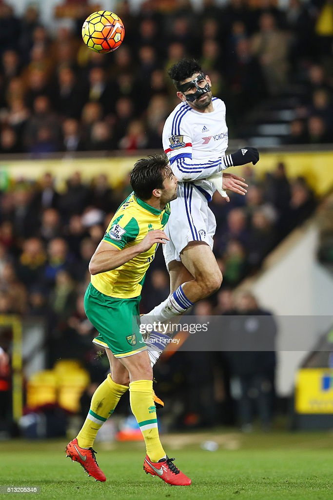 Diego Costa of Chelsea and Russel Martin of Norwich City compete for the ball during the Barclays Premier League match between Norwich City and Chelsea at Carrow Road on March 1, 2016 in Norwich, England.