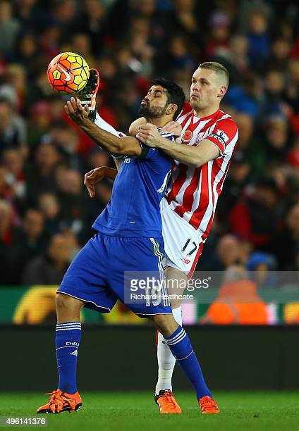 Diego Costa of Chelsea and Ryan Shawcross of Stoke City compete for the ball during the Barclays Premier League match between Stoke City and Chelsea...