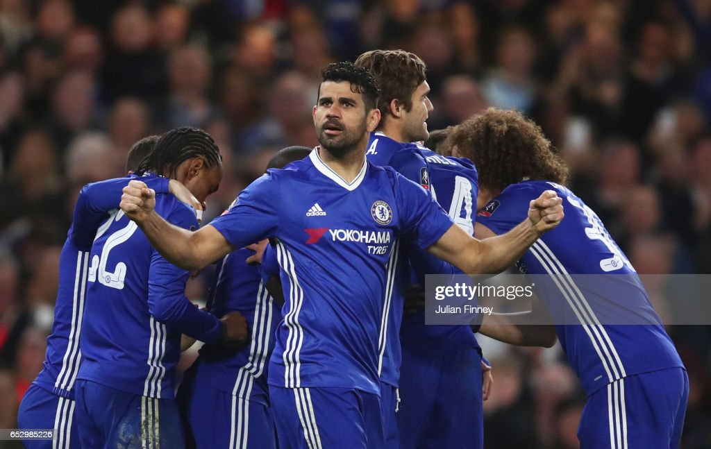 Diego Costa of Chelsea and team mates celebrate as N'Golo Kante of Chelsea (obscured) scores their first goal during The Emirates FA Cup Quarter-Final match between Chelsea and Manchester United at Stamford Bridge on March 13, 2017 in London, England.