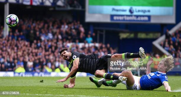 Diego Costa of Chelsea and Tom Davies of Everton during the Premier League match between Everton and Chelsea at Goodison Park on April 30 2017 in...