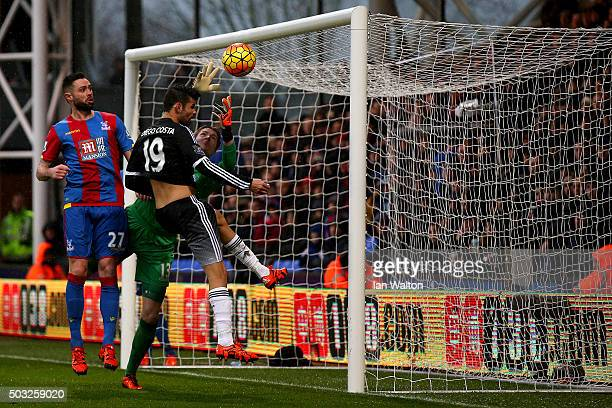 Diego Costa of Chelsea attempts to head the ball in past Wayne Hennessey of Crystal Palace during the Barclays Premier League match between Crystal...
