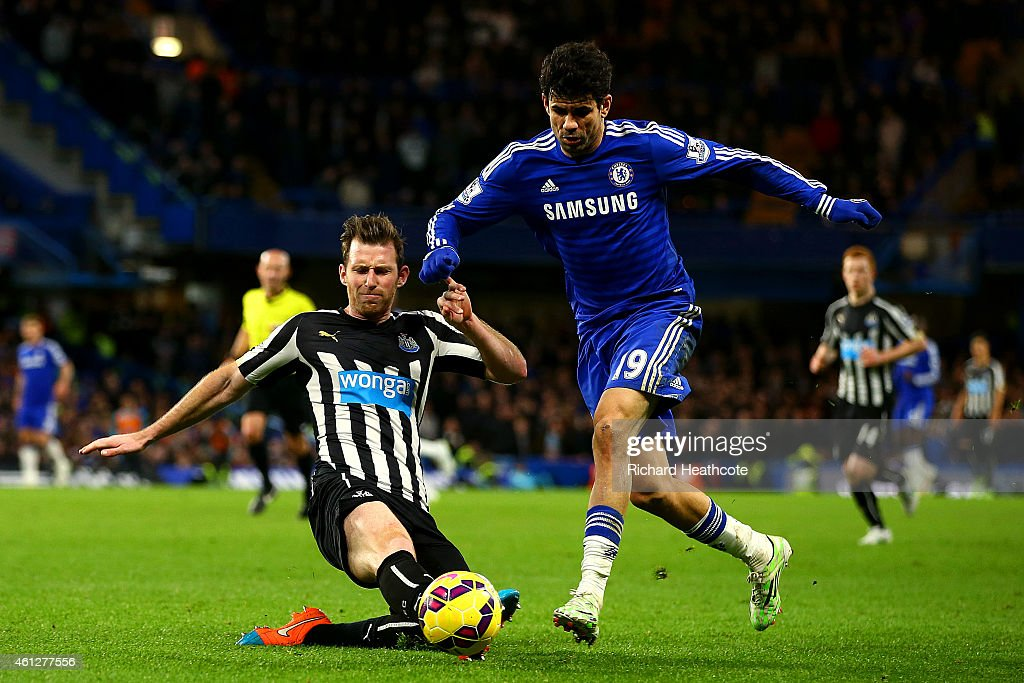 Diego Costa of Chelsea battles for the ball with Michael Williamson of Newcastle United during the Barclays Premier League match between Chelsea and Newcastle United at Stamford Bridge on January 10, 2015 in London, England.