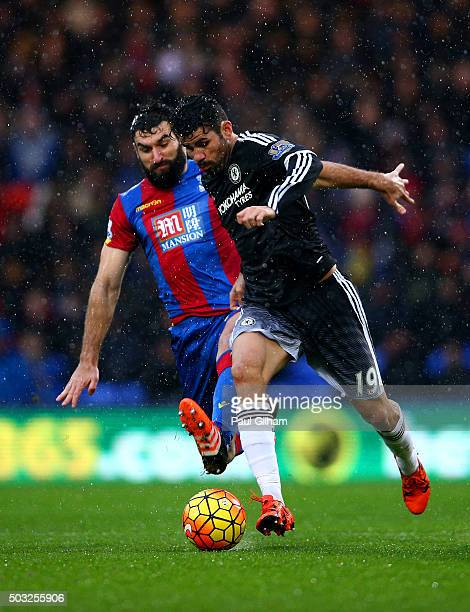 Diego Costa of Chelsea battles for the ball with Mile Jedinak of Crystal Palace during the Barclays Premier League match between Crystal Palace and...
