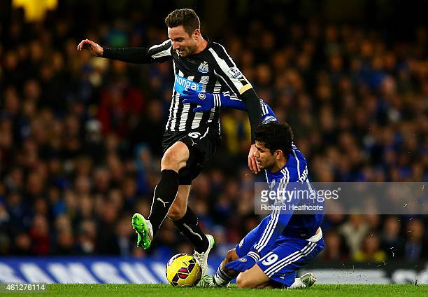 Diego Costa of Chelsea battles for the ball with Paul Dummett of Newcastle United during the Barclays Premier League match between Chelsea and...