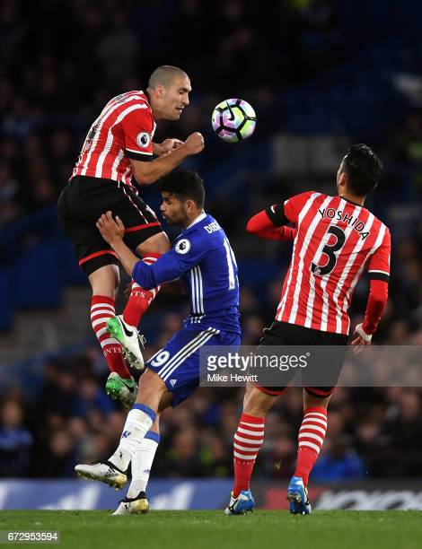 Diego Costa of Chelsea battles with Oriol Romeu and Maya Yoshida of Southampton during the Premier League match between Chelsea and Southampton at...