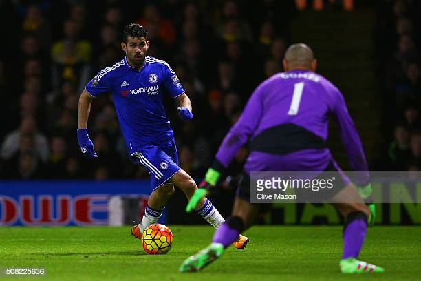 Diego Costa of Chelsea bears down on goalkeeper Heurelho Gomes of Watford during the Barclays Premier League match between Watford and Chelsea at...