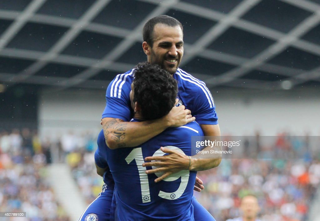 Diego Costa of Chelsea celebrate the scoring the goal with Cesc Fabregas (TOP) during the Pre Season Friendly match between FC Olimpija Ljubljana and Chelsea at Stozice stadium in Ljubljana, Slovenia on Sunday, July 27, 2014.