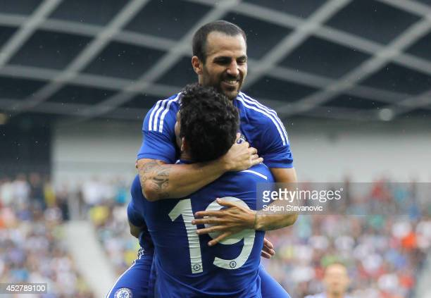 Diego Costa of Chelsea celebrate the scoring the goal with Cesc Fabregas during the Pre Season Friendly match between FC Olimpija Ljubljana and...