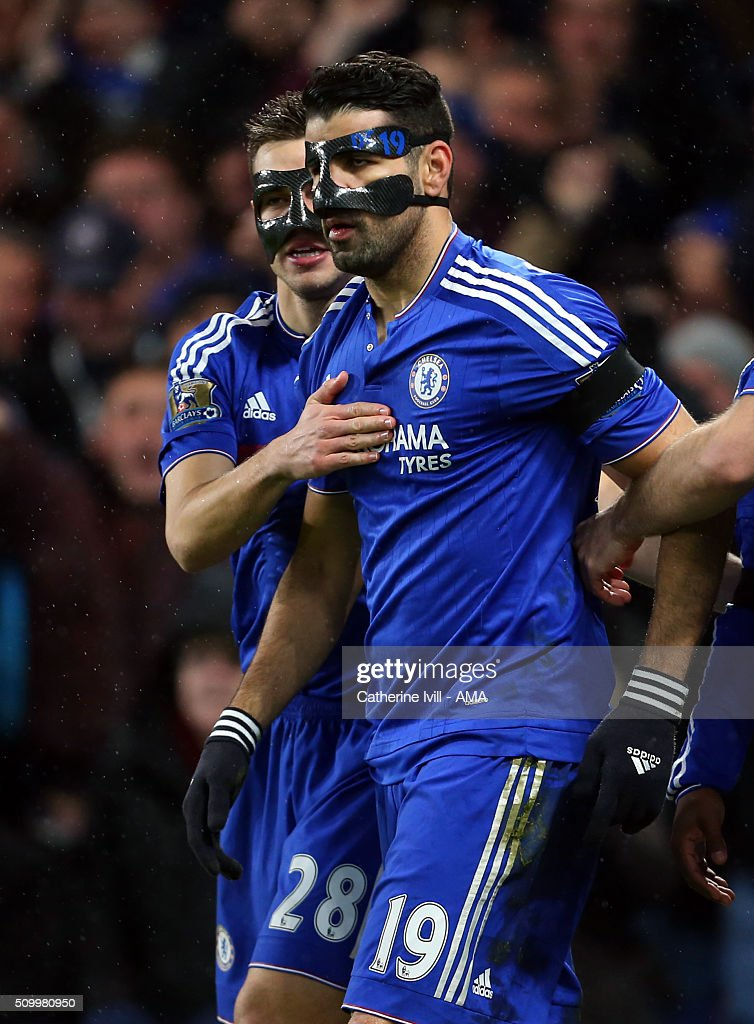 Diego Costa of Chelsea celebrates after he scores to make it 1-0 with Cesar Azpilicueta of Chelsea both wearing protective face masks during the Barclays Premier League match between Chelsea and Newcastle United at Stamford Bridge on February 13, 2016 in London, England.