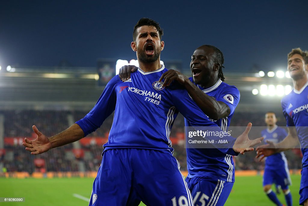 Diego Costa of Chelsea celebrates after scoring to make it 0-2 with Victor Moses of Chelsea during the Premier League match between Southampton and Chelsea at St Mary's Stadium on October 30, 2016 in Southampton, England.