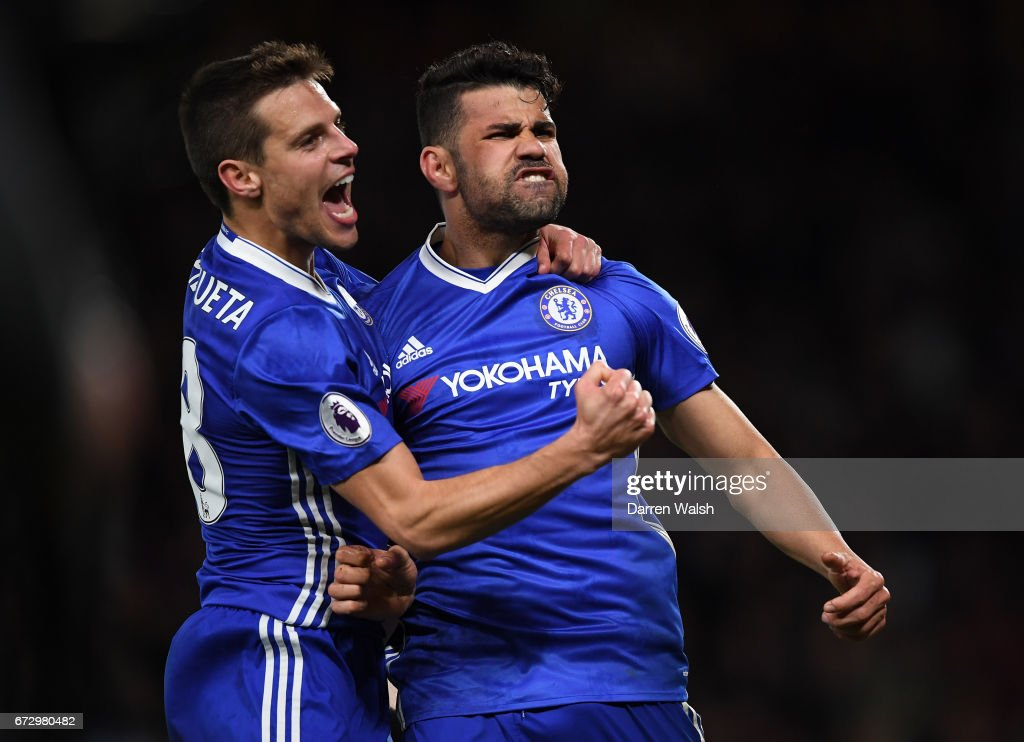 Diego Costa of Chelsea (R) celebrates as he scores their fourth goal with team mate Cesar Azpilicueta during the Premier League match between Chelsea and Southampton at Stamford Bridge on April 25, 2017 in London, England.