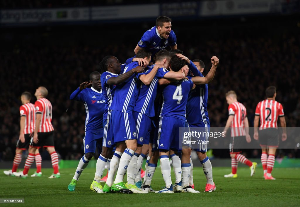 Diego Costa of Chelsea (obscured) celebrates as he scores their third goal with team mates during the Premier League match between Chelsea and Southampton at Stamford Bridge on April 25, 2017 in London, England.