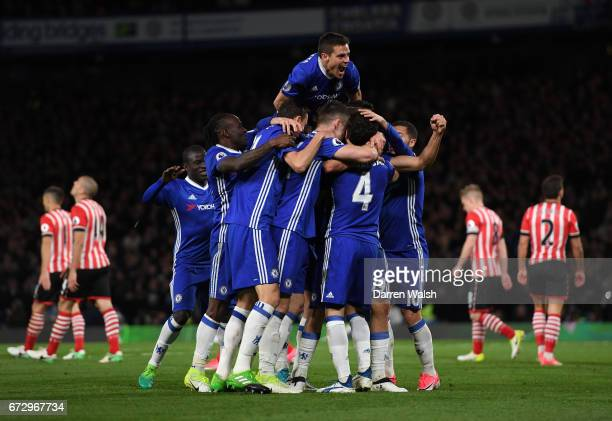 Diego Costa of Chelsea celebrates as he scores their third goal with team mates during the Premier League match between Chelsea and Southampton at...