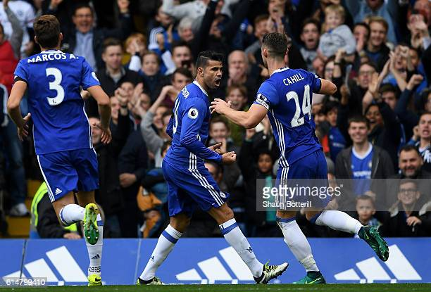 Diego Costa of Chelsea celebrates scoring his sides first goal with team mate Gary Cahill of Chelsea during the Premier League match between Chelsea...