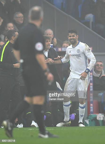 Diego Costa of Chelsea celebrates scoring his sides first goal with Antonio Conte Manager of Chelsea during the Premier League match between Crystal...
