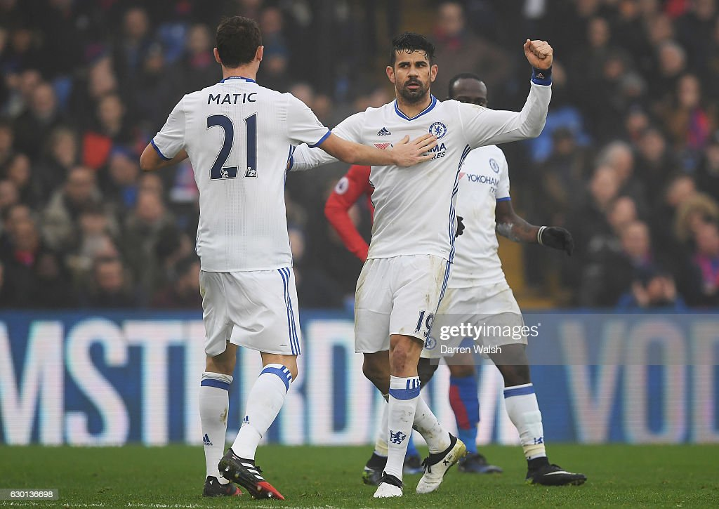 Diego Costa of Chelsea (R) celebrates scoring his sides first goal with Nemanja Matic of Chelsea (L) during the Premier League match between Crystal Palace and Chelsea at Selhurst Park on December 17, 2016 in London, England.