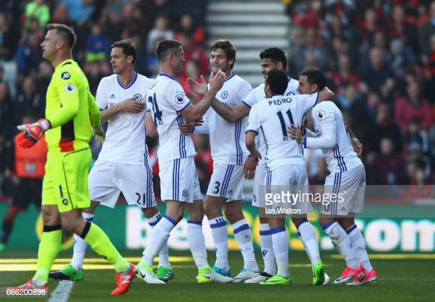 Diego Costa of Chelsea celebrates scoring his sides first goal with Chelsea team mates during the Premier League match between AFC Bournemouth and...