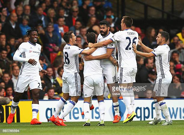 Diego Costa of Chelsea celebrates scoring his sides second goal with his team mates during the Premier League match between Watford and Chelsea at...