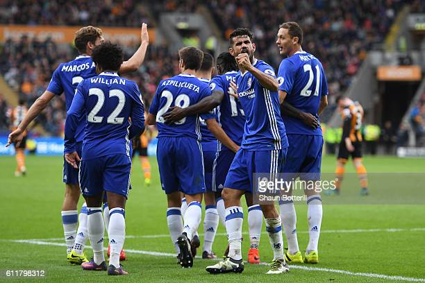 Diego Costa of Chelsea celebrates scoring his sides second goal with his team mates during the Premier League match between Hull City and Chelsea at...