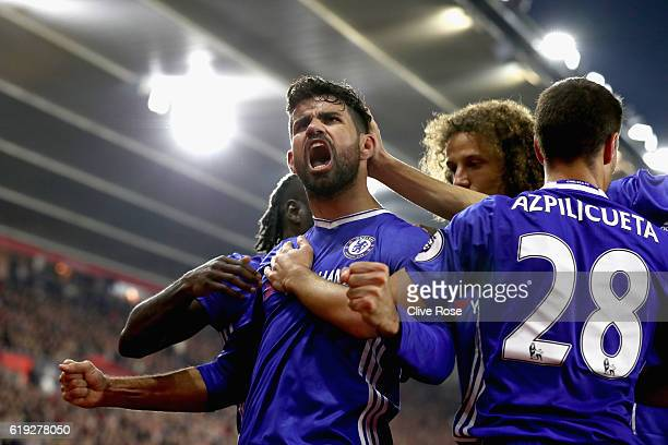 Diego Costa of Chelsea celebrates scoring his sides second goal with his Chelsea team mates during the Premier League match between Southampton and...