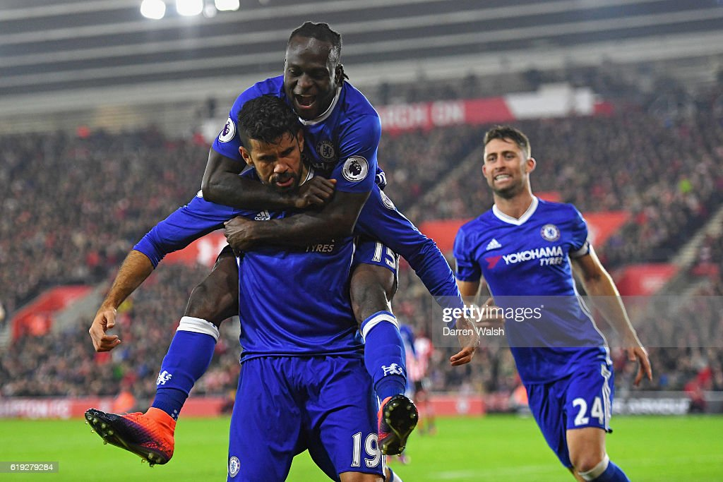 Diego Costa of Chelsea (L) celebrates scoring his sides second goal with Victor Moses of Chelsea (C) during the Premier League match between Southampton and Chelsea at St Mary's Stadium on October 30, 2016 in Southampton, England.