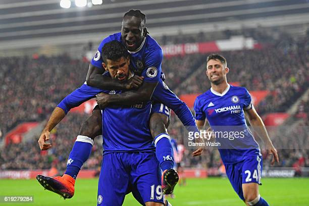 Diego Costa of Chelsea celebrates scoring his sides second goal with Victor Moses of Chelsea during the Premier League match between Southampton and...