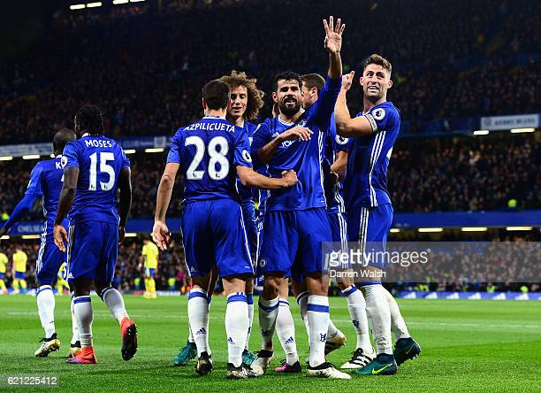 Diego Costa of Chelsea celebrates scoring his sides third goal with his Chelsea team mates during the Premier League match between Chelsea and...