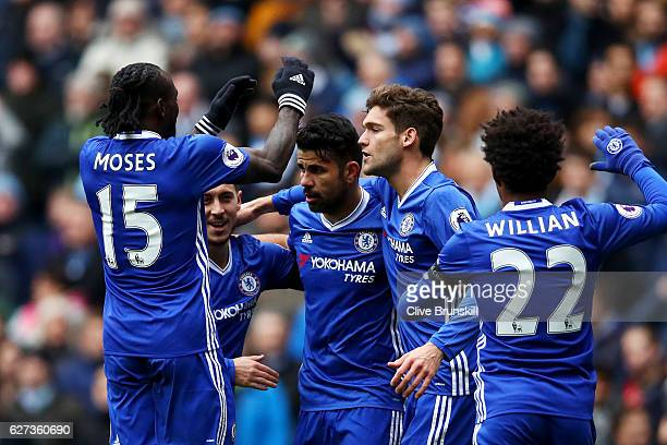 Diego Costa of Chelsea celebrates scoring his team's first goal with his team mates during the Premier League match between Manchester City and...