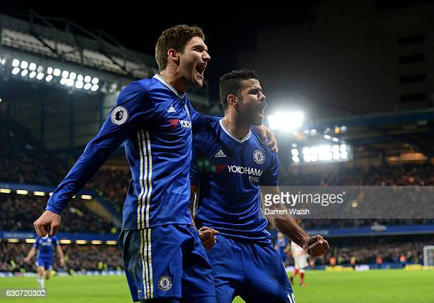 Diego Costa of Chelsea celebrates scoring his team's fourth goal with his team mate Marcos Alonso during the Premier League match between Chelsea and...
