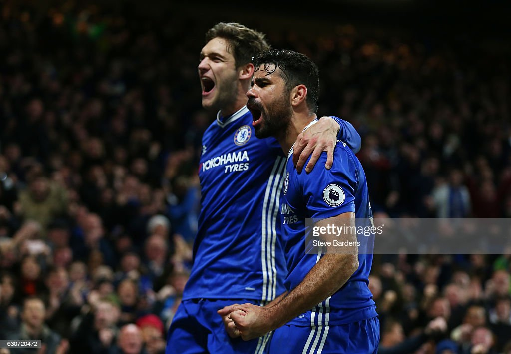 Diego Costa (R) of Chelsea celebrates scoring his team's fourth goal with his team mate Marcos Alonso (L) during the Premier League match between Chelsea and Stoke City at Stamford Bridge on December 31, 2016 in London, England.