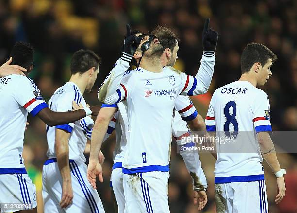 Diego Costa of Chelsea celebrates scoring his team's second goal with his team mates during the Barclays Premier League match between Norwich City...