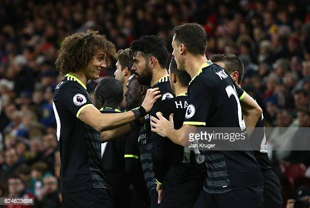 Diego Costa of Chelsea celebrates scoring the opening goal with David Luiz during the Premier League match between Middlesbrough and Chelsea at...