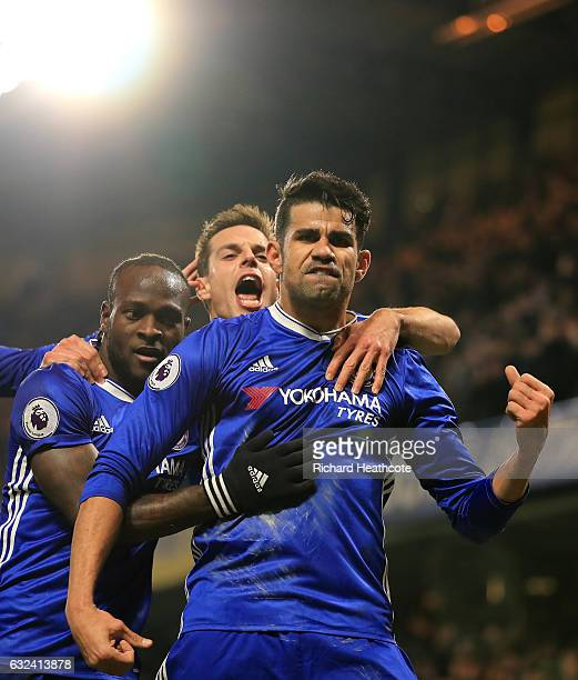 Diego Costa of Chelsea celebrates scoring the opening goal with his team mates during the Premier League match between Chelsea and Hull City at...