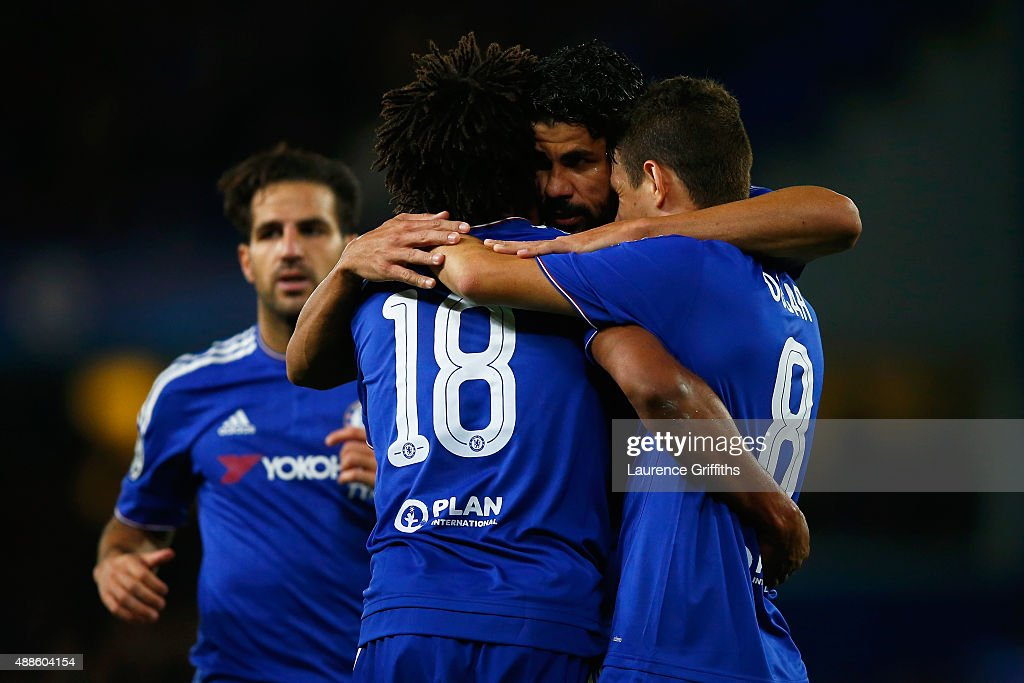 Diego Costa of Chelsea celebrates scoring their third goal with Loic Remy and Oscar of Chelsea during the UEFA Chanmpions League group G match between Chelsea and Maccabi Tel-Aviv FC at Stamford Bridge on September 16, 2015 in London, United Kingdom.