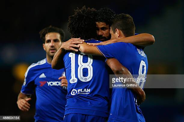 Diego Costa of Chelsea celebrates scoring their third goal with Loic Remy and Oscar of Chelsea during the UEFA Chanmpions League group G match...