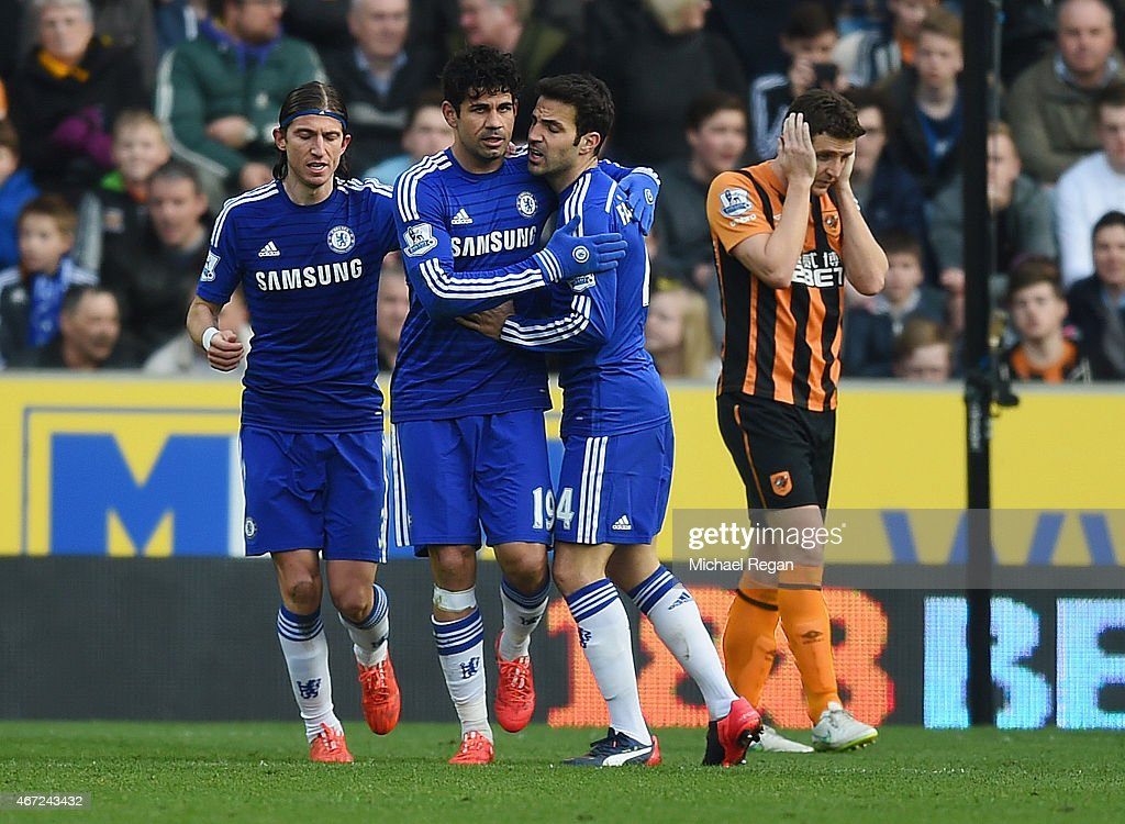 Diego Costa of Chelsea (2L) celebrates with Filipe Luis (L) and Cesc Fabregas (2R) as he scores their second goal during the Barclays Premier League match between Hull City and Chelsea at KC Stadium on March 22, 2015 in Hull, England.