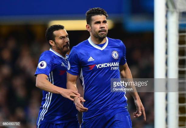 Diego Costa of Chelsea celebrates with Pedro after scoring his sides first goal during the Premier League match between Chelsea and Middlesbrough at...