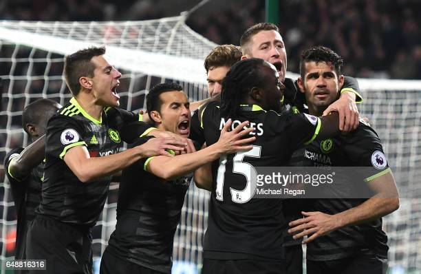 Diego Costa of Chelsea celebrates with team mates after scoring his sides second goal during the Premier League match between West Ham United and...
