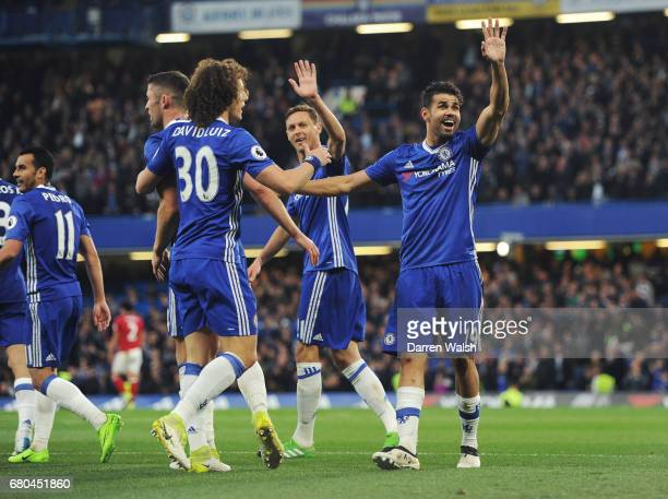 Diego Costa of Chelsea celebrates with team mates after scoring his sides first goal during the Premier League match between Chelsea and...
